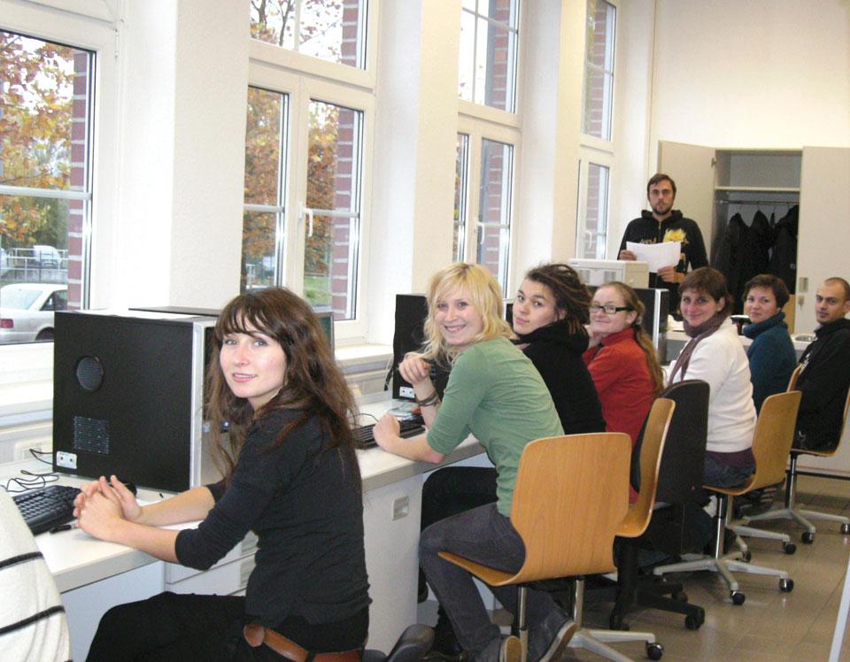 Seminarteilnehmer in Schulungsraum